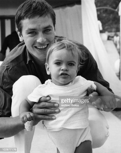 French actor Alain Delon with his son Anthony on the beach at Monte Carlo 15th August 1965