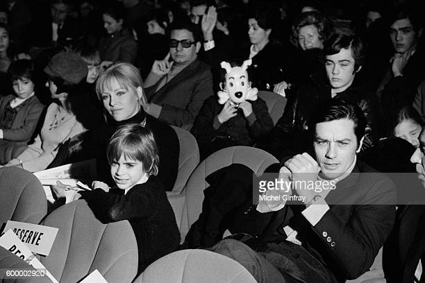 French actor Alain Delon with his wife actress Nathalie Delon and their son Anthony at the premiere of the film Tintin in Paris