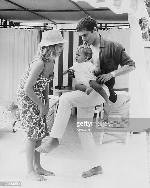 French actor Alain Delon with his wife Nathalie and their son Anthony on the beach at Monte Carlo 15th August 1965