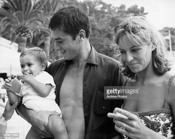 French actor Alain Delon with his wife Nathalie and their son Anthony on the beach at Monte Carlo, 15th August 1965.