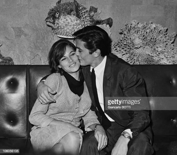 French actor Alain Delon with his wife Nathalie at Orly airport after his return from United States in 1965 in France