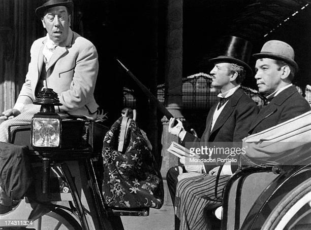 French actor and comedian Fernandel carrying Mexican actor and comedian Cantinflas and British actor David Niven on a gig in Around the World in 80...