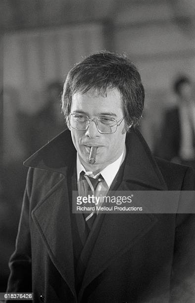 French actor and comedian Guy Bedos smokes a cigar on the set of the 1976 film Un Elephant ca Trompe Enormement The film directed by Yves Robert also...