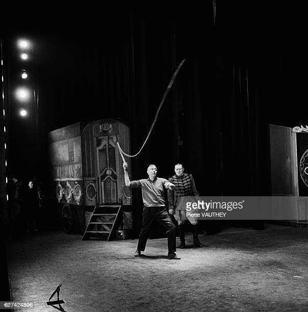 French actor and filmmaker Jacques Tati rehearses with a bullwhip at the  Olympia in Paris Tati