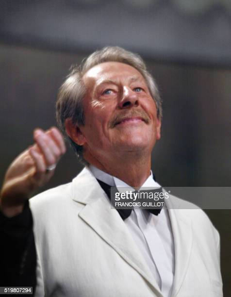 French actor and jury member Jean Rochefort is applauded on the stage of the palais des festivals during the opening ceremony of the 56th Cannes film...