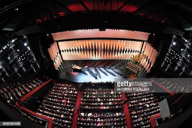 TOPSHOT French actor and Master of Ceremony Edouard Baer delivers a speech on stage on May 8 2018 during the opening ceremony of the 71st edition of...
