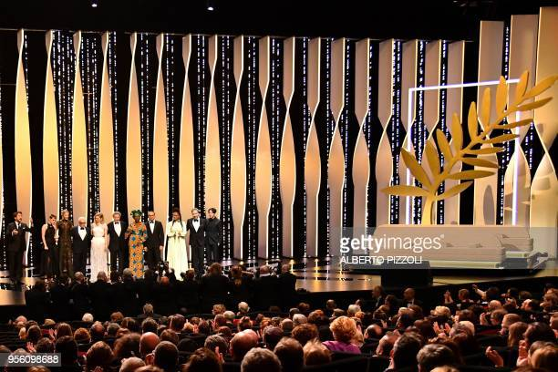 TOPSHOT French actor and Master of Ceremony Edouard Baer poses on stage on May 8 2018 with Australian actress and President of the Jury Cate...