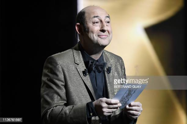 French actor and master of ceremony Kad Merad performs during the 44th edition of the Cesar Film Awards ceremony at the Salle Pleyel in Paris on...
