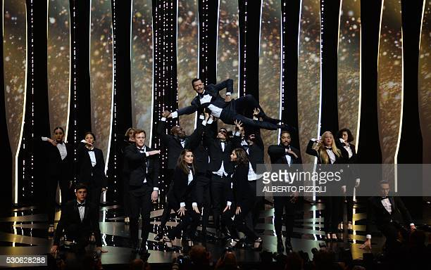 TOPSHOT French actor and Master of Ceremony Laurent Lafitte performs on stage on May 11 2016 during the opening ceremony for the 69th Cannes Film...