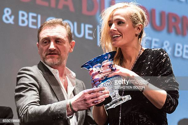 French actor and President of the jury, Jean-Paul Rouve gives the jury price to French filmmaker Julia Ducournau during the prize ceremony of the...
