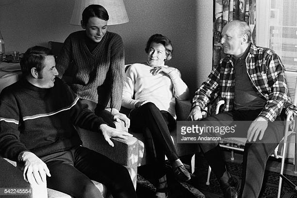 French actor and singer André Bourvil with wife Jeanne Lefrique and sons Dominique and Philipps Raimbourg on winter sports holiday