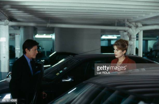 French actor and singer Jacques Dutronc and actress Catherine Deneuve on the set of the film Place Vendome directed by Nicole Garcia