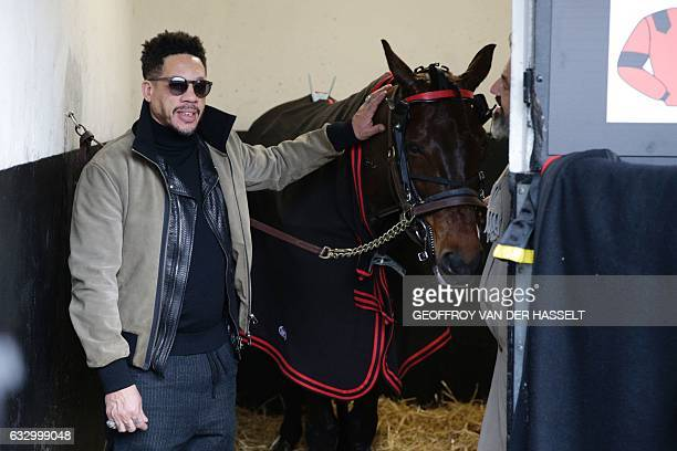 French actor and singer Joey Starr poses with the 2016 Prix D'Amerique champion Bold Eagle before the 97th Prix d'Amerique equestrian trotting world...