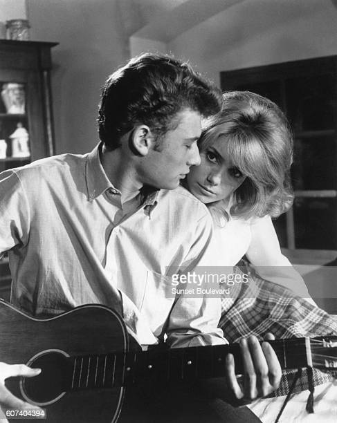 French actor and singer Johnny Hallyday and actress Catherine Deneuve on the set of Les parisiennes directed by Marc Allegret