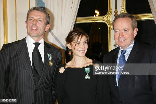 French actor and singer Lambert Wilson recipiant of the Officier de l'Ordre National des Arts et des Lettres award and French actress Clotilde Courau...