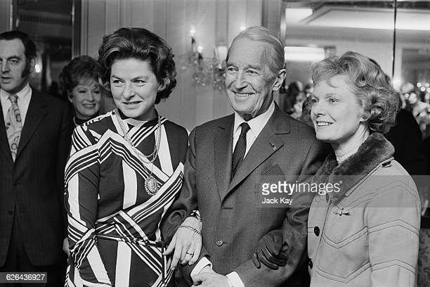 French actor and singer Maurice Chevalier with Swedish actress Ingrid Bergman and British actress Dame Anna Neagle at a Foyles literary lunch London...