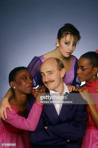 French actor and singer Michel Blanc surrounded by three admiring female dancers The photograph is a publicity shot for the release of Blanc's record...