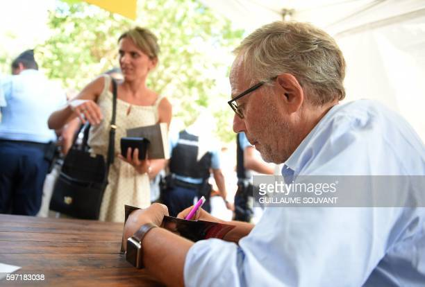 French actor and writer Fabrice Luchini signs autographs during the 21th book fair La Foret Des Livres on August 28 2016 in ChanceauxprèsLoches...
