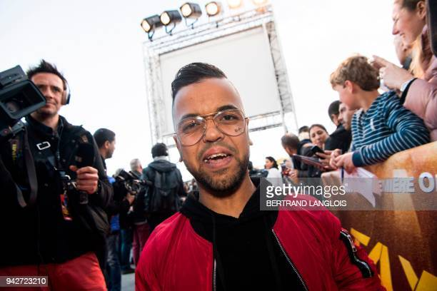 French actor Anouar Toubali arrives to attend a photocall for the premiere of the film 'Taxi 5' at the Plan de Campagne commercial area in Les...