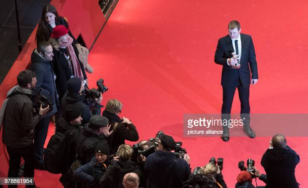 French actor Anthony Bajon holds up his silver bear for Best Actor for the film 'The Prayer' after the award ceremony of the 68th International...