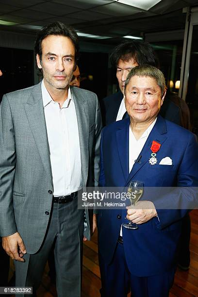 French actor Anthony Delon and artist Takeshi Kitano are pictured after Takeshi Kitano received the French Legion of Honor By Jack Lang at Fondation...