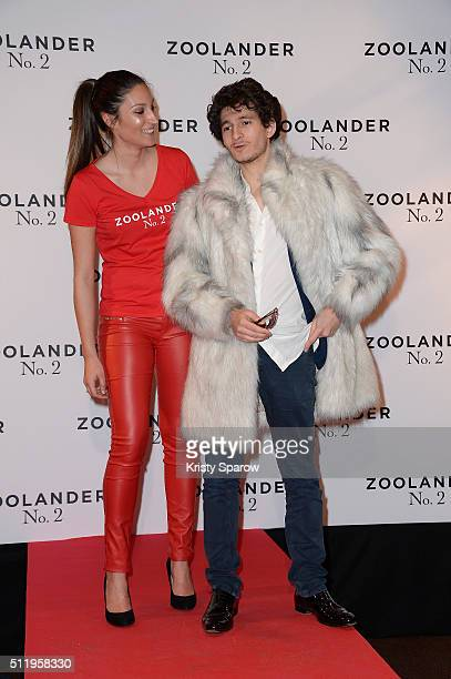 French actor Anthony Sonigo and a hostess attend the 'Zoolander 2' Paris Premiere at Cinema Gaumont Marignan on February 23 2016 in Paris France