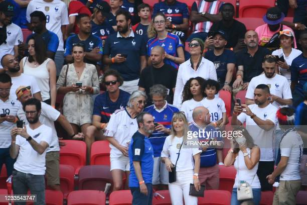 French actor Bruno Solo and Claude Deschamps , the wife of French coach Didier Deschamps are seen in the stands before the UEFA EURO 2020 Group F...