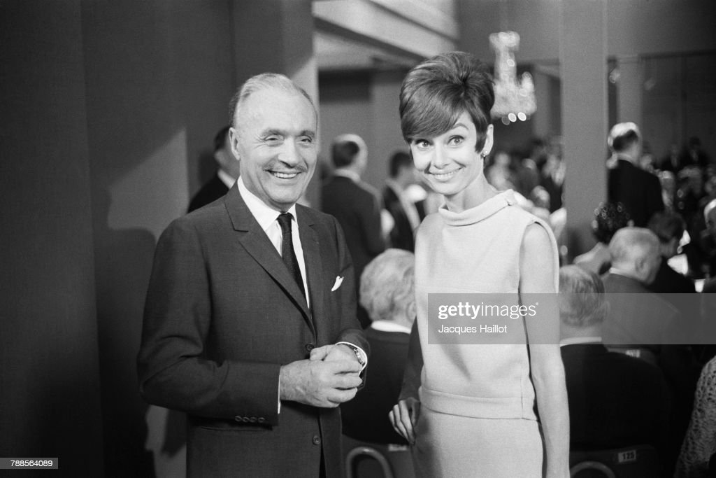 French actor Charles Boyer and British-Dutch actress Audrey Hepburn on the set of How to Steal a Million, directed by American director William Wyler.