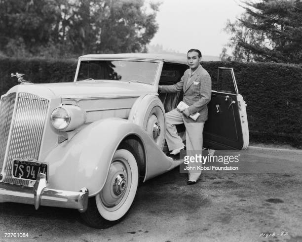 French actor Charles Boyer gets into a 1935 Packard, circa 1935.