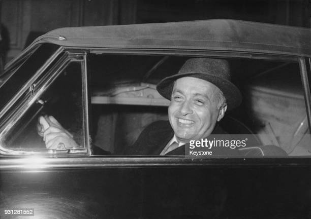 French actor Charles Boyer gets into his car after arriving on the boat train at SaintLazare station in Paris France 27th March 1953 He is in France...