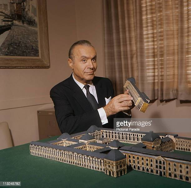 French actor Charles Boyer with a model building circa 1965
