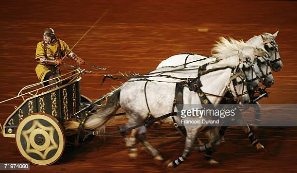 French actor Christophe Heraut plays BenHur and rides in a Roman chariot during the stage production premiere of BenHur September 22 2006 in...