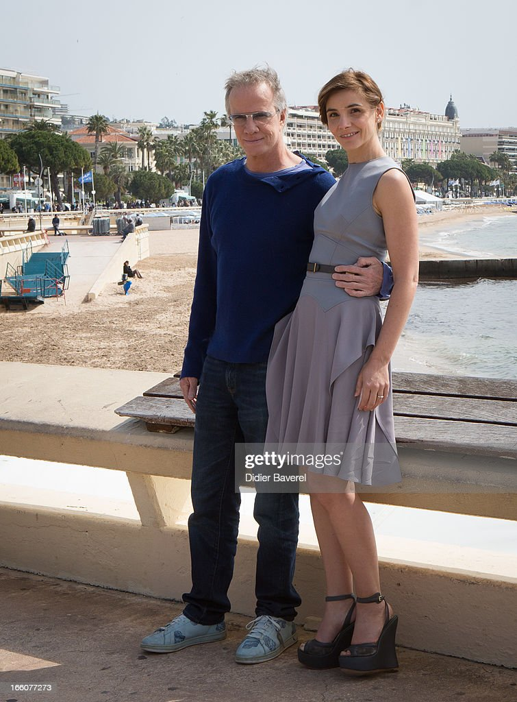 French actor Christophe Lambert and actress Clotilde Courau pose during a photocall for the tv series'La Source' at MIP TV 2013 on April 8, 2013 in Cannes, France.