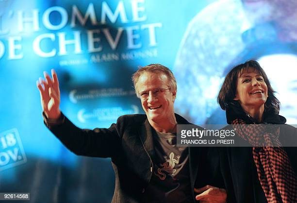 French actor Christophe Lambert and his companion French actress Sophie Marceau pose on November 2 2009 in Lomme northern France as they attend the...