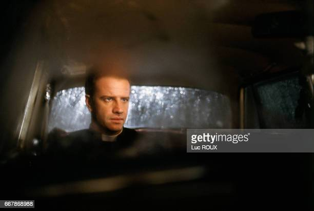 French actor Christophe Lambert on the set of the film To Kill a Priest directed by Agnieszka Holland Also know as Le Complot the film is inspired by...
