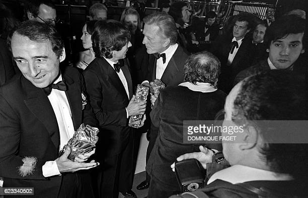 French actor Claude Brasseur Polish French director Roman Polanski and US actor Kirk Douglas are pictured during 5th nuit des Cesar ceremony on...