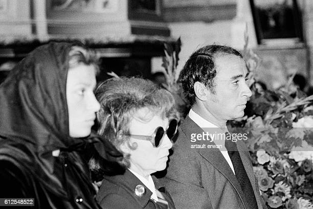 French actor Claude Brasseur with his wife Michele Cambon and mother actress Odette Joyeux attend the funeral of his father actor Pierre Brasseur