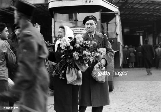 French actor Claude Dauphin welcomes his wife, French actress Rosine Deréan returning from concentration camp on April 14, 1945 at the Gare du Nord...