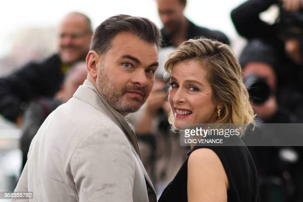 """French actor Clovis Cornillac and French actress Karin Viard pose on May 14, 2018 during a photocall for the film """"Little Tickles """" at the 71st..."""