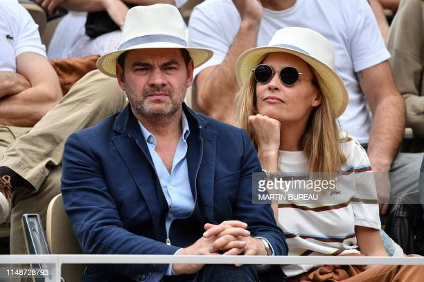 French actor Clovis Cornillac and French actress Lilou Fogli attend the men's singles final match between Spain's Rafael Nadal and Austria's Dominic...