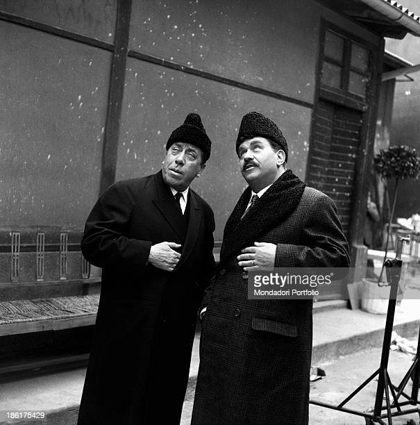 French actor comedian and singer Fernandel and Italian actor Gino Cervi looking up in the film Don Camillo in Moscow Brescello 1965