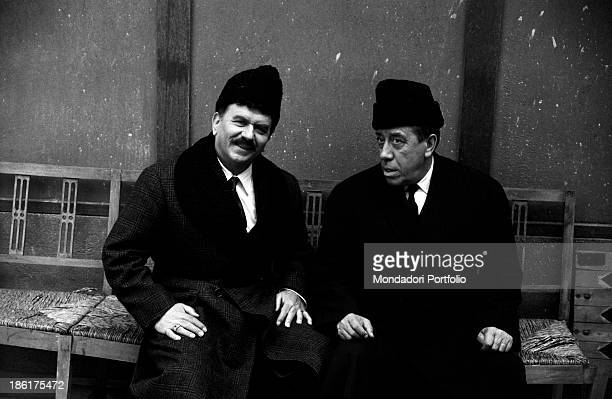 French actor comedian and singer Fernandel looking far away while Italian actor Gino Cervi smiles in the film Don Camillo in Moscow Brescello 1965