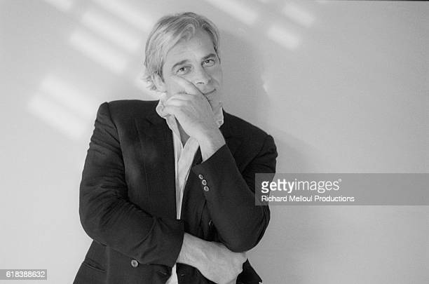 French actor director and screenwriter Jacques Weber puts a hand to his face as he leans against a wall in Paris In 1990 he is starring in a oneman...