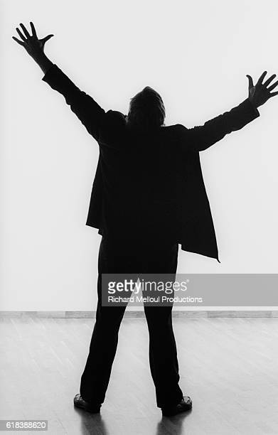 French actor director and screenwriter Jacques Weber stands with arms outstretched in Paris In 1990 he is starring in a oneman show