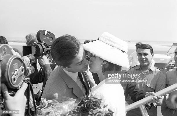 French actor director and singer Alain Delon kissing his parter and Austrianborn French actress Romy Schneider at the 15th Cannes film festival...