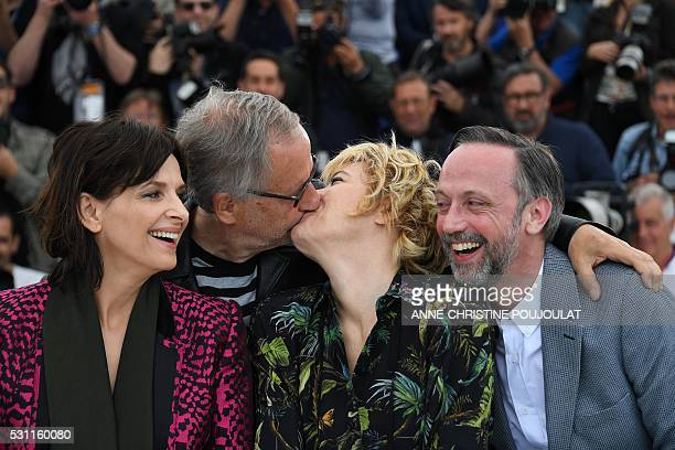 TOPSHOT French actor Fabrice Luchini and Italian actress Valeria Bruni Tedeschi kiss on May 13 2016 while posing with French actress Juliette Binoche...