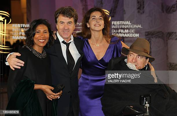 French actor Francois Cluzet and his wife Narjiss pose with French businessman Philippe Pozzo Di Borgo and his wife as they arrive at the 11th...