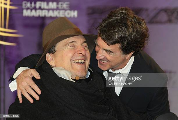 French actor Francois Cluzet poses with French businessman Philippe Pozzo Di Borgo as they arrive at the 11th Marrakech International Film Festival...
