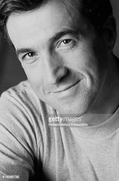 French actor Francois Cluzet smiles in Paris