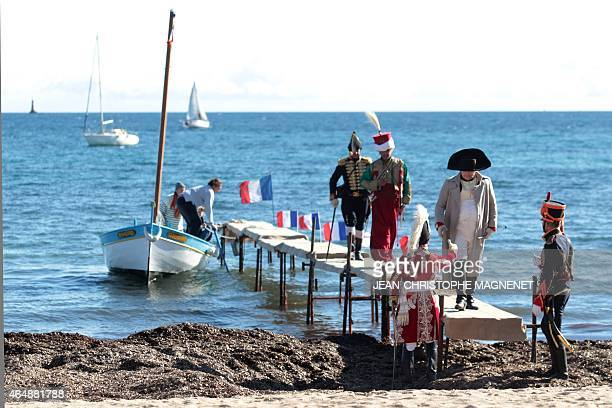 French actor Frank Samson dressed as French Emperor Napoleon Ier performs during the reenactment of Napoleon's landing on March 1st in Vallauris...